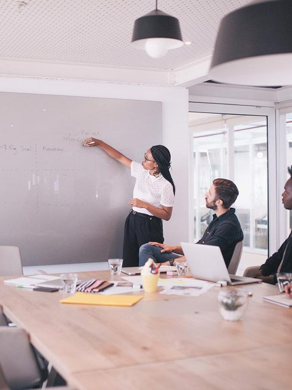 technology-office-businesswoman-laptop-together-meeting-team-whiteboard-start-up-board-room_t20_Ae6721